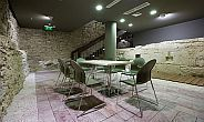 meeting room surrounded by the remains of a medieval water-tower - Hotel Lanchid 19 in Budapest